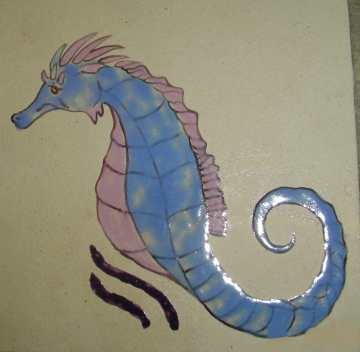 Ceramic art tile of a blue seahorse
